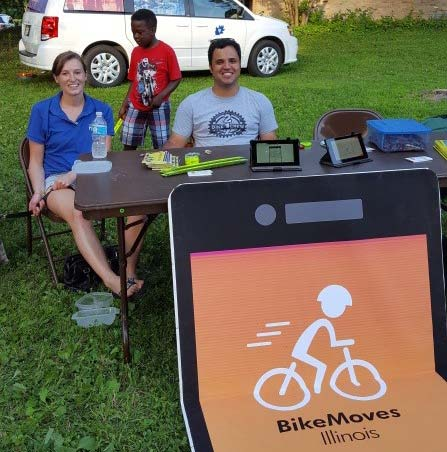 Hannah and Gabe staff the BikeMoves table at Larson Park.
